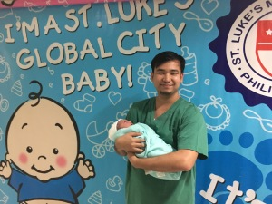husband with newborn at St. Luke's hospital