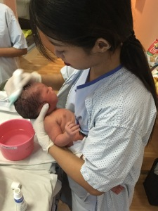 Nurse gives infant first bath